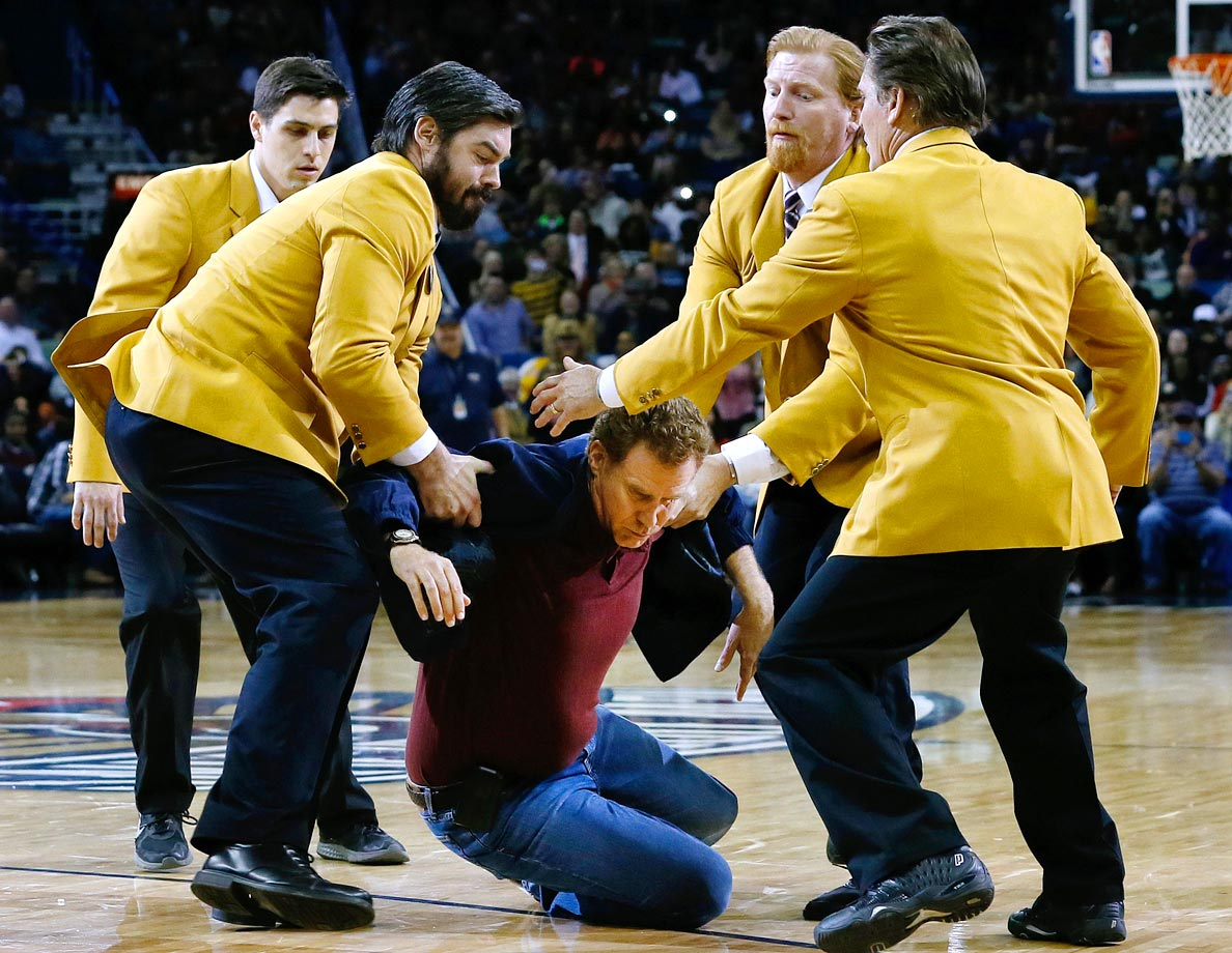"Will Ferrell is dragged by actors dressed as security guards while filming part of a scene for the motion picture ""Daddy's Home"" during halftime of the New Orleans Pelicans game against the Los Angeles Lakers on Jan. 21, 2015 at the Smoothie King Center in New Orleans."