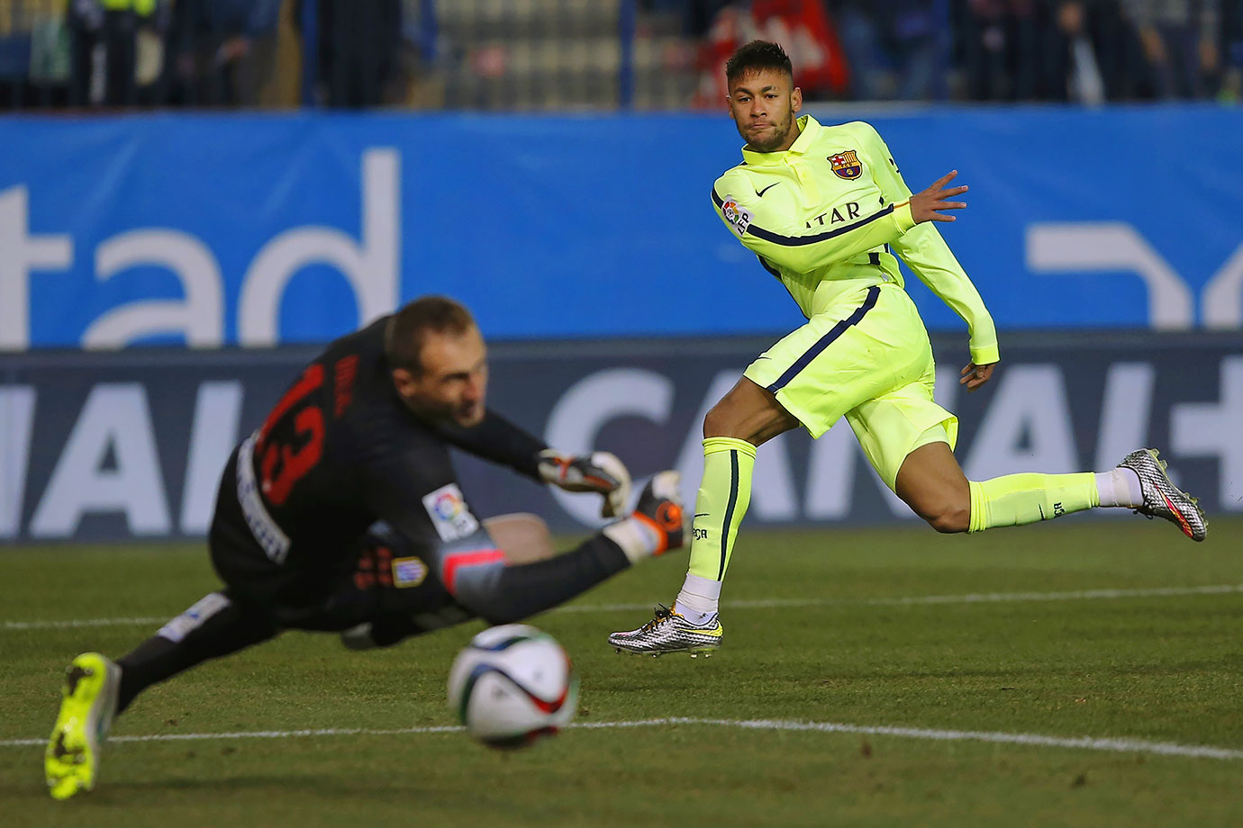 Neymar scores a goal for Barcelona against Atletico de Madrid's Jan Oblak during their Copa del Rey quarterfinal match on Jan. 28, 2015 at the Vicente Calderon Stadium in Madrid, Spain.