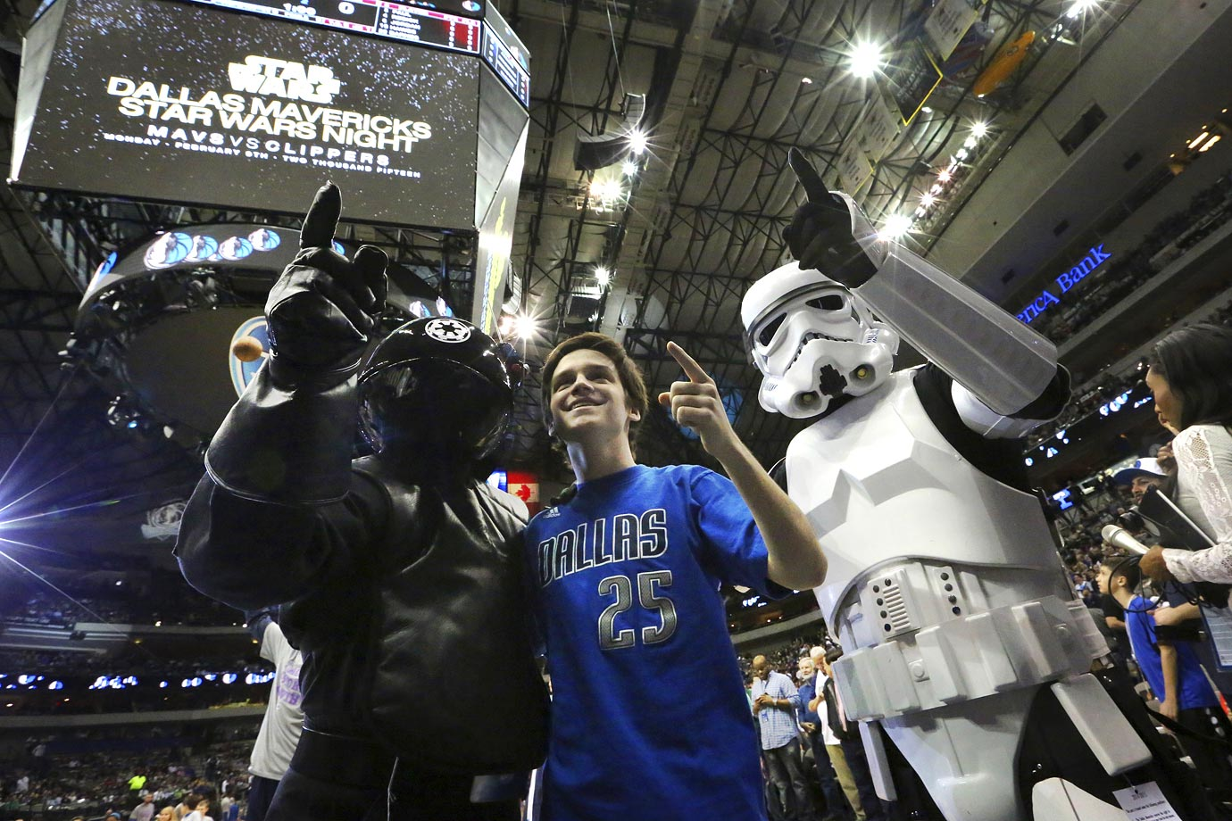 "A Dallas Mavericks fan poseswith Star Wars costume clad fans before the Mavs game against the Los Angeles Clippers during ""Star Wars Night"" on Feb. 9, 2015 at American Airlines Center in Dallas."