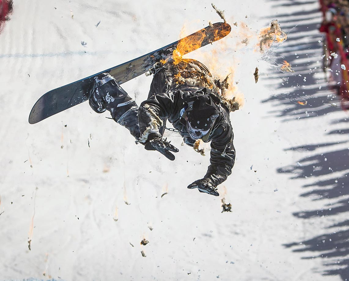 A snowboarder performs during the Red Bull Jump and Freeze competition.