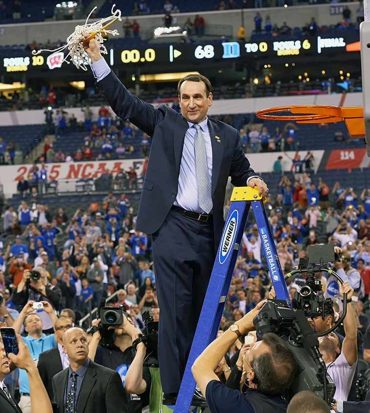 Blue Devils head coach Mike Krzyzewski cut down the nets on Duke's fifth national championship this past April, after beating Wisconsin in the finals. While UCLA's John Wooden has twice as many championships (in an amazing 12-year run, no less), Coach K has done so in a much more difficult era, with players leaving for the NBA before their senior seasons. (Wooden had both Lew Alcindor and then Bill Walton for six of those 10 championship years).