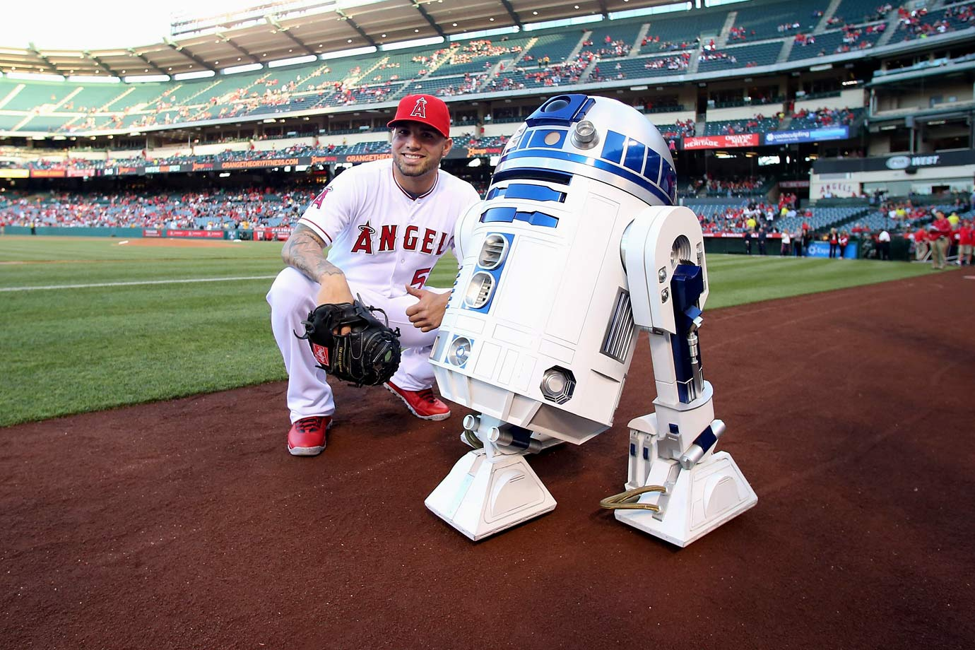 "Los Angeles Angels pitcher Hector Santiago poses with R2-D2 on ""Star Wars Night"" before the Angels game against the Oakland Athletics on April 20, 2015 at Angel Stadium in Anaheim, Calif."