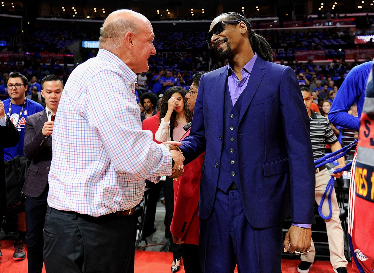 Los Angeles Clippers owner Steve Ballmer greets Snoop Dogg prior to the Clippers game against the Houston Rockets on May 8, 2015 at Staples Center in Los Angeles.