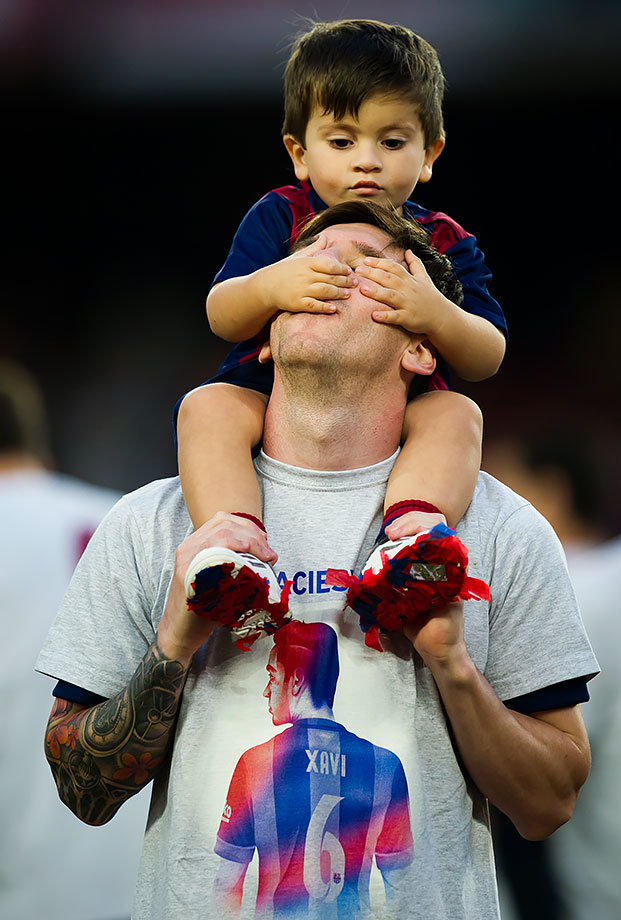 Barcelona's Lionel Messi plays with his son Thiago after the La Liga match against Deportivo La Coruna on May 23, 2015 at Camp Nou stadium in Barcelona, Spain.