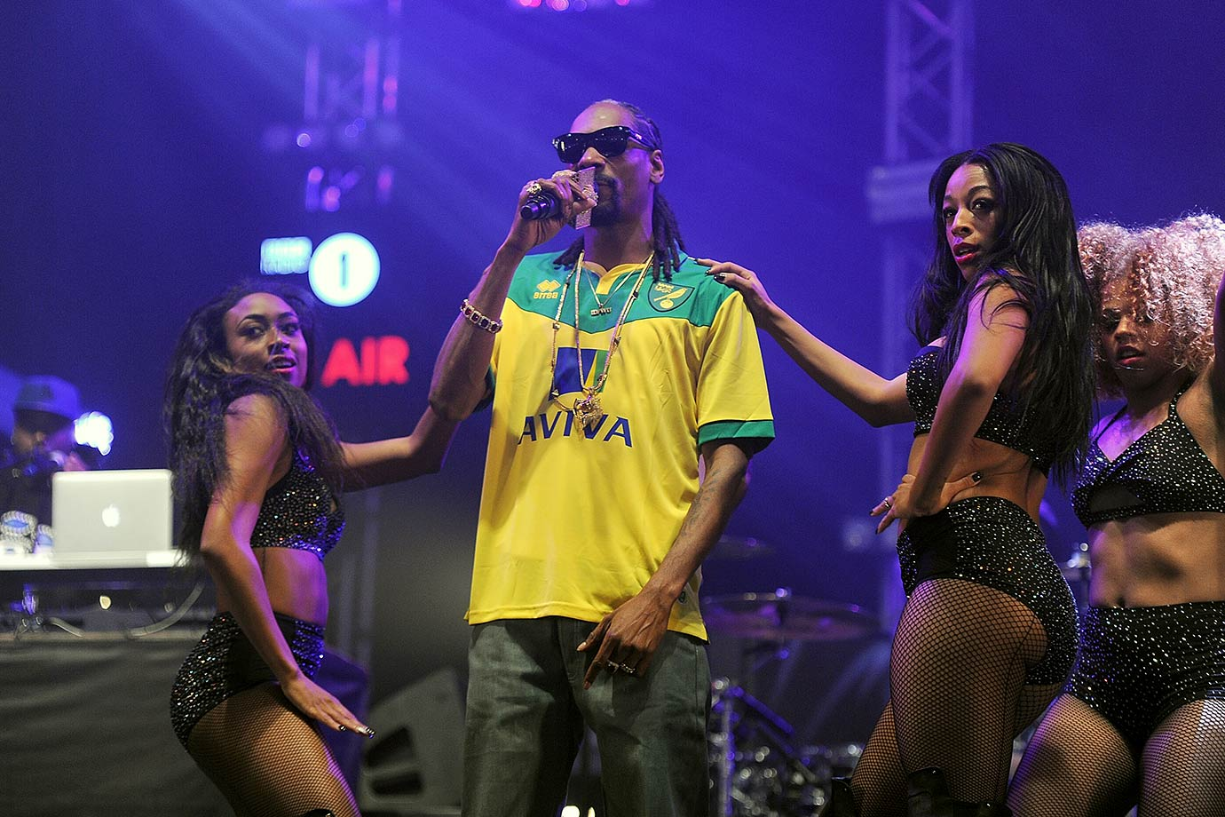 Snoop Dogg performs on stage, wearing a Norwich City F.C. football shirt, during day one of BBC Radio 1's Big Weekend at Earlham Park on May 23, 2015 in Norwich, England.