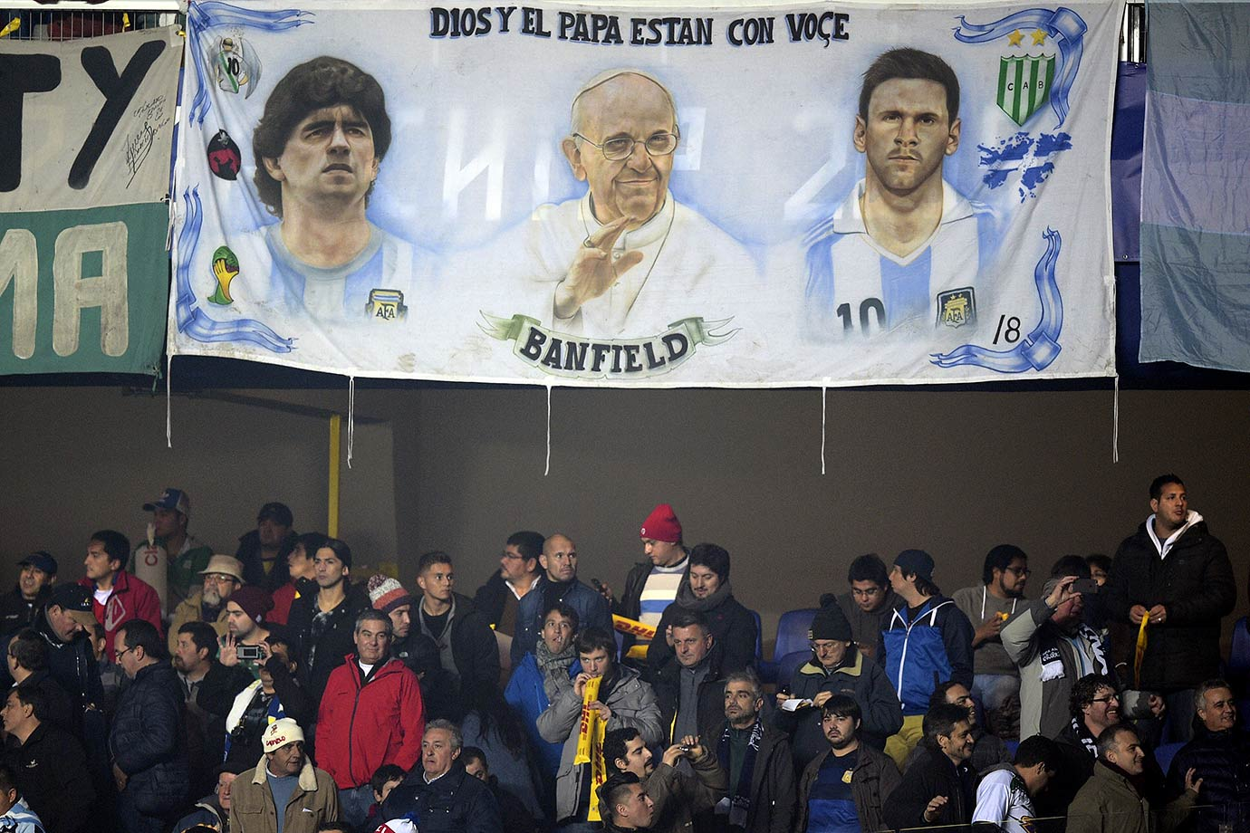 A banner depicting Diego Maradona, Pope Francis and Lionel Messi hangs before the start of Argentina's Copa America semifinal match against Paraguay on June 30, 2015 in Concepcion, Chile.
