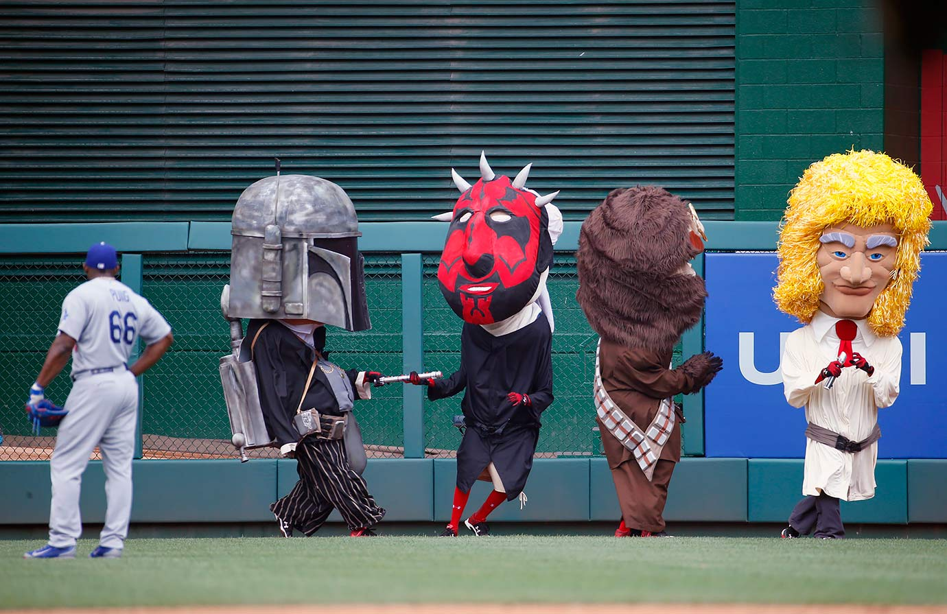 Los Angeles Dodgers right fielder Yasiel Puig watches the Washington Nationals Presidents Race mascots dressed as Star Wars characters during the game on July 19, 2015 at Nationals Park in Washington, D.C.