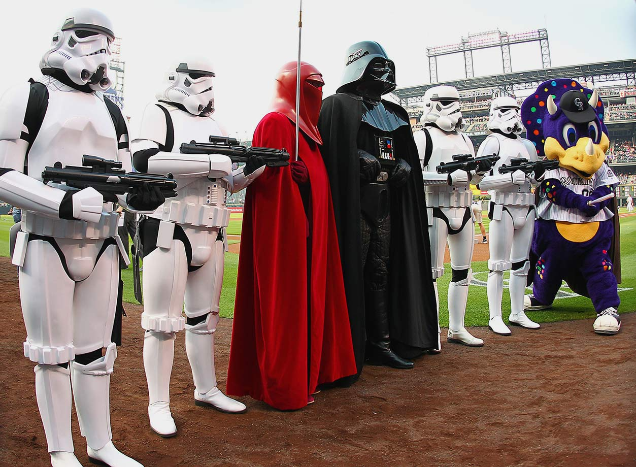 "Colorado Rockies mascot Dinger poses with characters on ""Star Wars Night"" prior to the game against the New York Mets on Aug. 22, 2015 at Coors Field in Denver."
