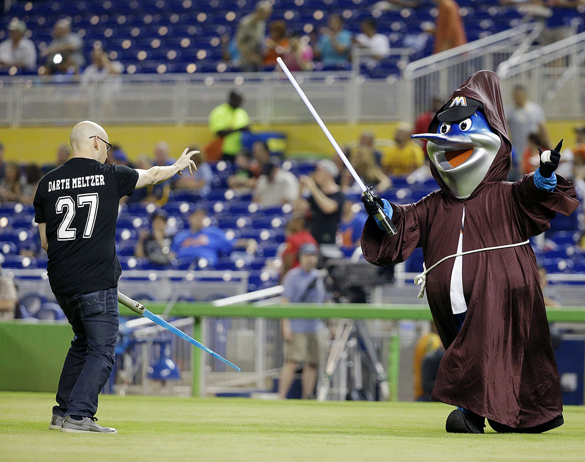 "Brad Meltzer and Florida Marlins mascot Billy the Marlin get into the spirit of ""Star Wars Night"" before the game against the New York Mets on Sept. 4, 2015 at Marlins Park in Miami."