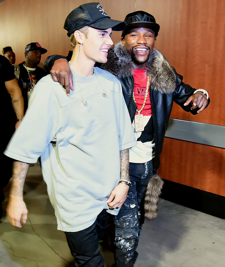 "Justin Bieber and Floyd Mayweather Jr. walk backstage during ""An Evening with Justin Bieber"" on Nov. 13, 2015 at Staples Center in Los Angeles."