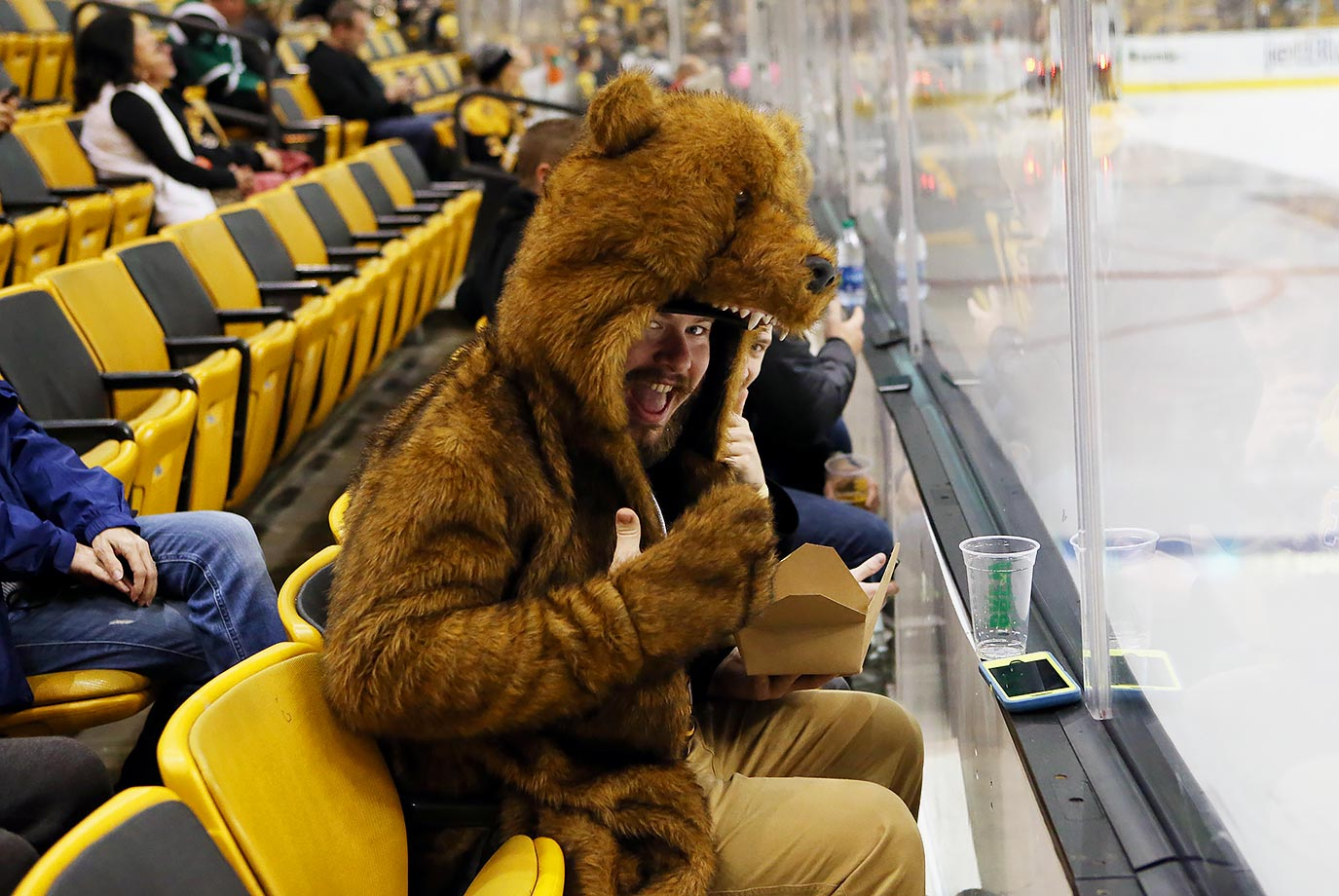 It must get cold sitting so close to the ice for this Boston Bruins fan.