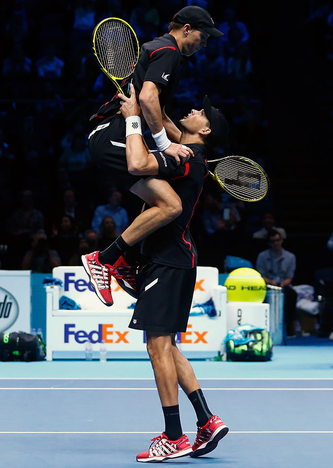 Twins Mike and Bob Bryan celebrate in a final dance move gone wrong.