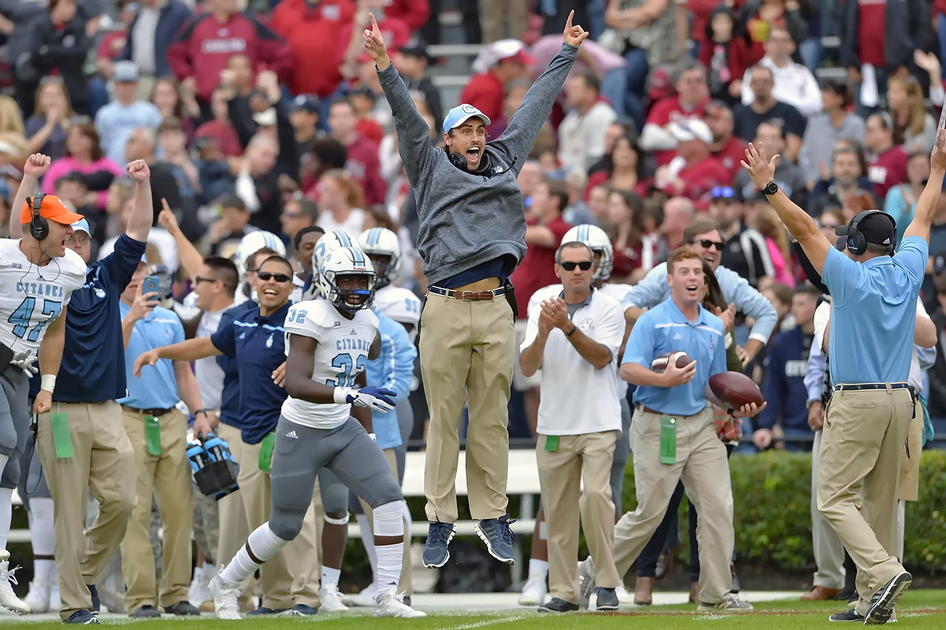 A member of the Citadel coaching staff manages to celebrate while stiff as a board.