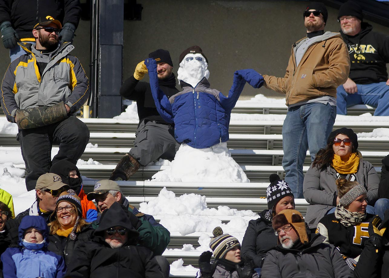 One loyal Iowa fan doesn't seem to mind the cold.