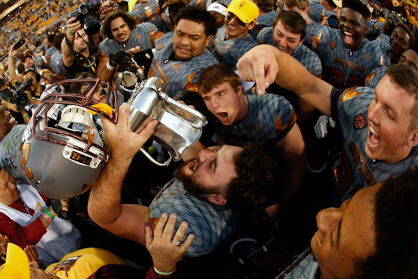 Arizona State fullback Mark Cosgrove can tilt the Territorial Cup all he wants, there's nothing to drink out of it.