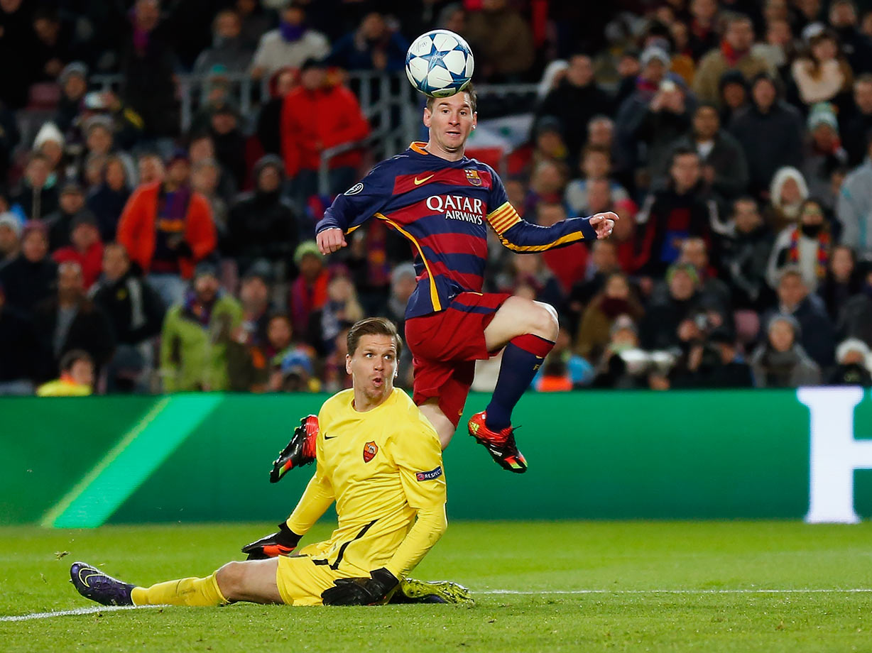Barcelona's Lionel Messi scores his side's second goal past Roma goalkeeper Wojciech Szczesny during their Group E Champions League match on Nov. 24, 2015 at the Camp Nou stadium in Barcelona, Spain.