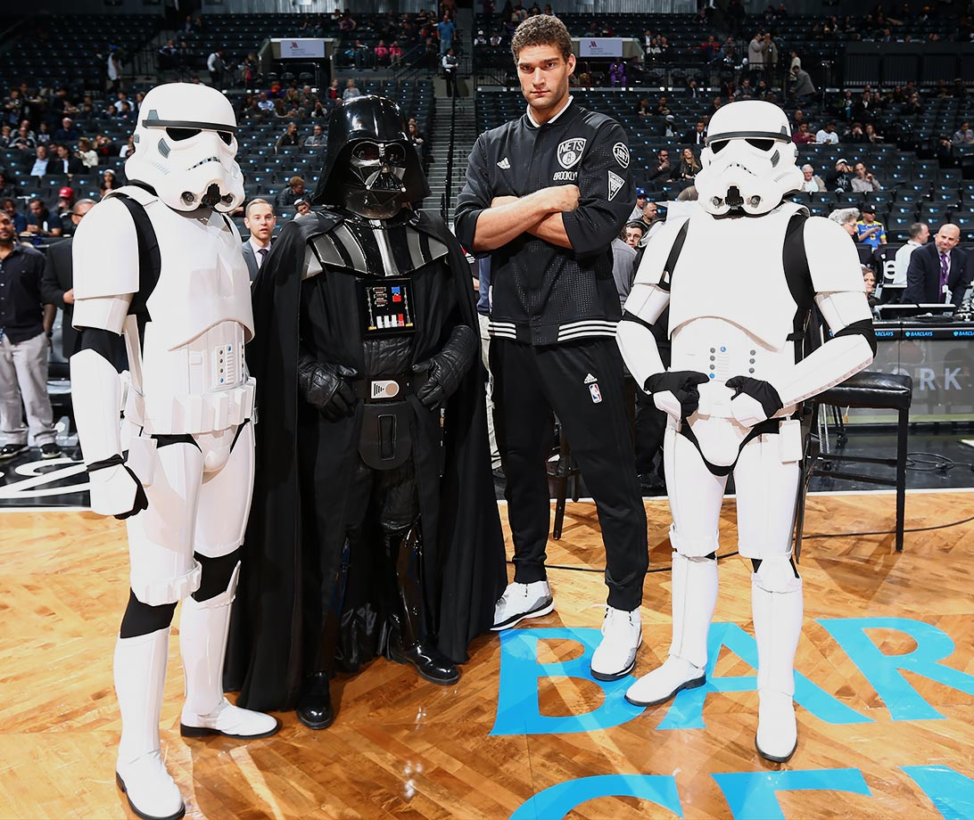 Brooklyn Nets center Brook Lopez poses with Star Wars characters before a game against the Orlando Magic on Dec. 14, 2015 at Barclays Center in Brooklyn, N.Y.