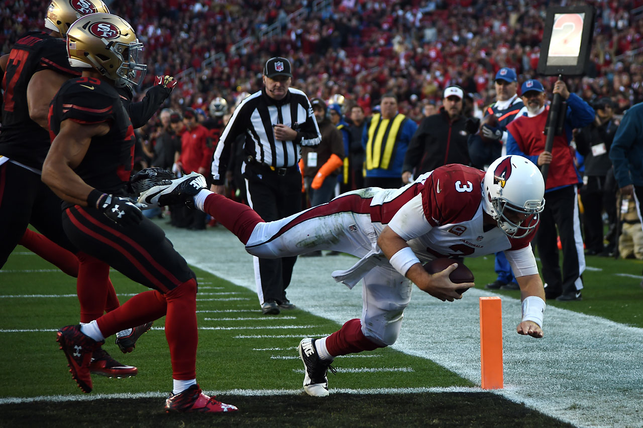 Palmer dives into the end zone for the go-ahead touchdown with 2:28 remaining in a 19-13 victory over San Francisco on Nov. 29. It marked his first win against the 49ers (in five tries) and was the Cardinals fifth straight win of the season.