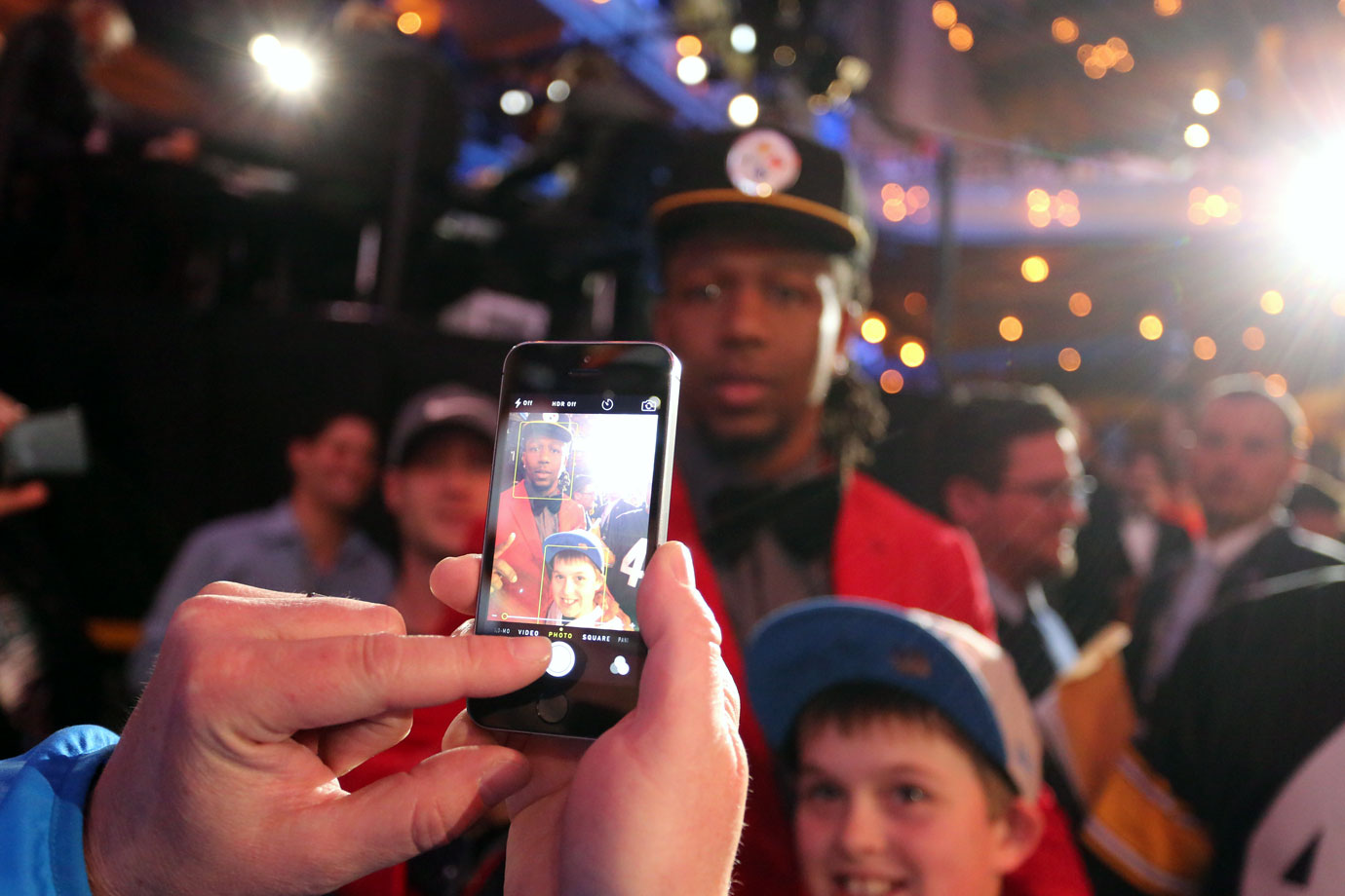 Kentucky linebacker Alvin (Bud) Dupree took time to pose with a young fan after being selected by the Steelers with the 22nd pick.