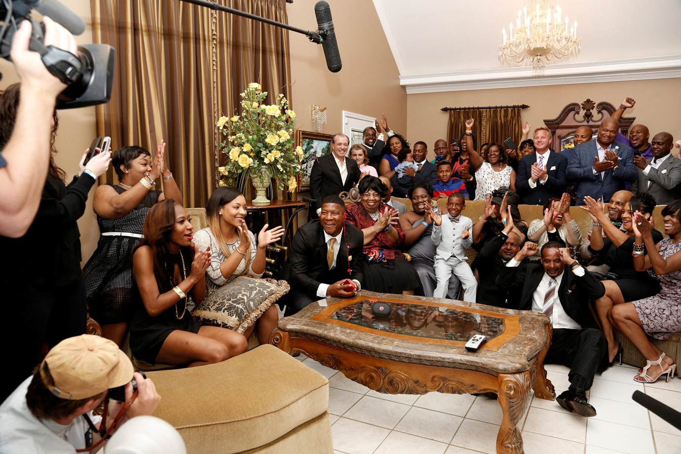 The draft's No. 1 pick, Florida State quarterback Jameis Winston (center, gold tie), celebrated with family and friends as he received his selection call from the Buccaneers.