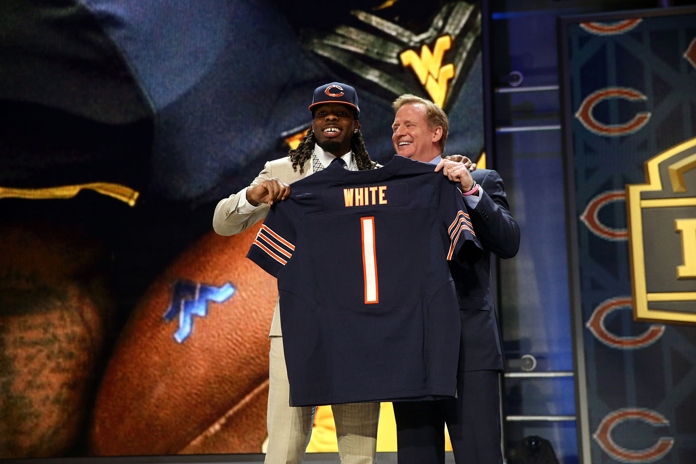 West Virginia wide receiver Kevin White shows off his new Bears jersey to the local crowd after being selected by Chicago with the seventh pick.