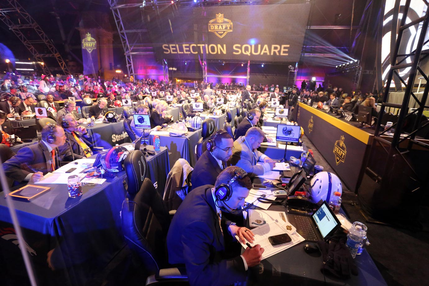 Team representatives monitor selections and relay info on draft prospects to and from their clubs in a makeshift draft-day war room next to Roosevelt University's Auditorium Theater in Chicago.