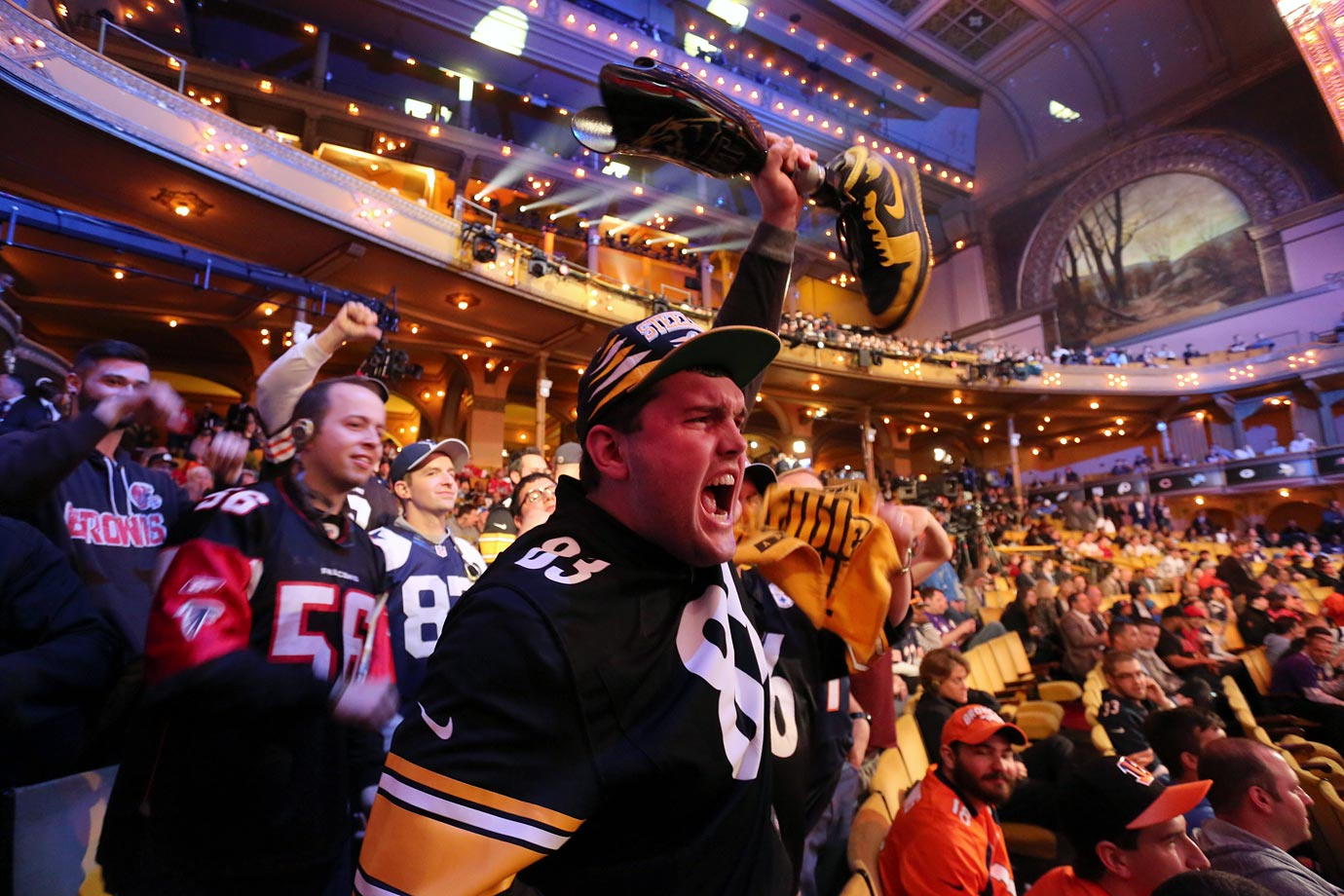 A Steelers fan waves his prosthetic leg in the air to celebrate PIttsburgh's selection of Alvin Dupree.