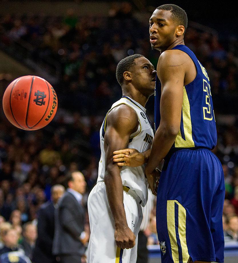 Notre Dame's Demetrius Jackson attempts to stare down Georgia Tech's James White after a dunk but comes up a little short.