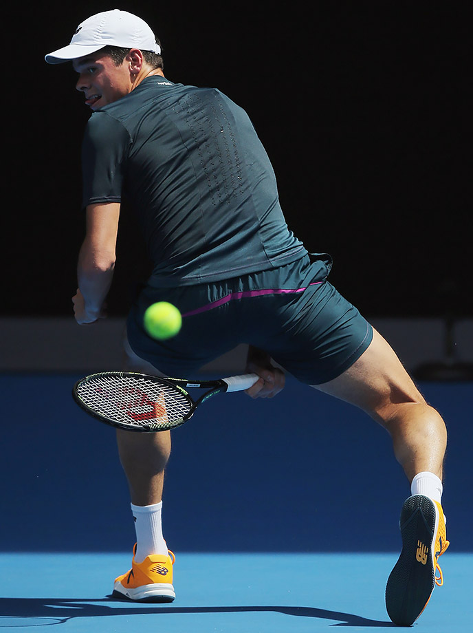 Milos Raonic hits the ball between his legs during a practice session ahead of the Australian Open.