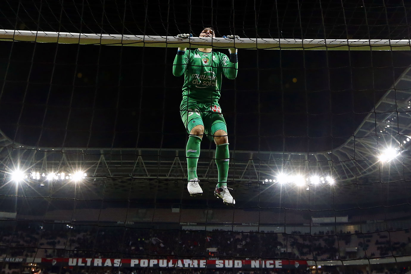 As OGC Nice's goalkeeper Yoan Cardinale swings from the goal post, he's probably wondering how he'll get down.