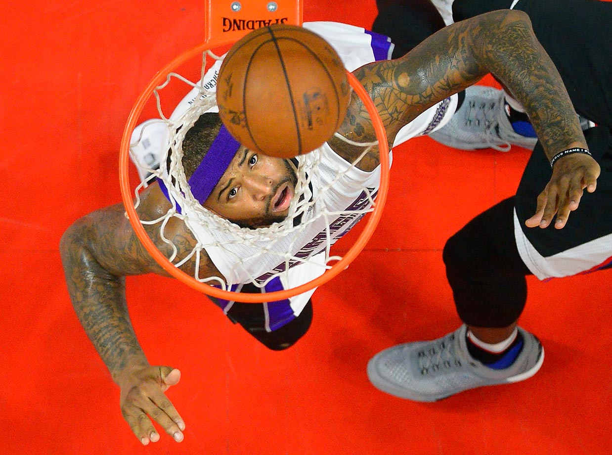 Sacramento Kings center DeMarcus Cousins watches a shot by the Los Angeles Clippers go in the basket.