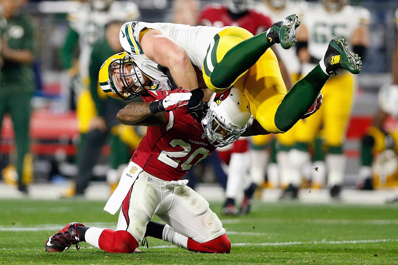 Arizona Cardinals safety Deone Bucannon appears to flip Green Bay Packers fullback John Kuhn over.