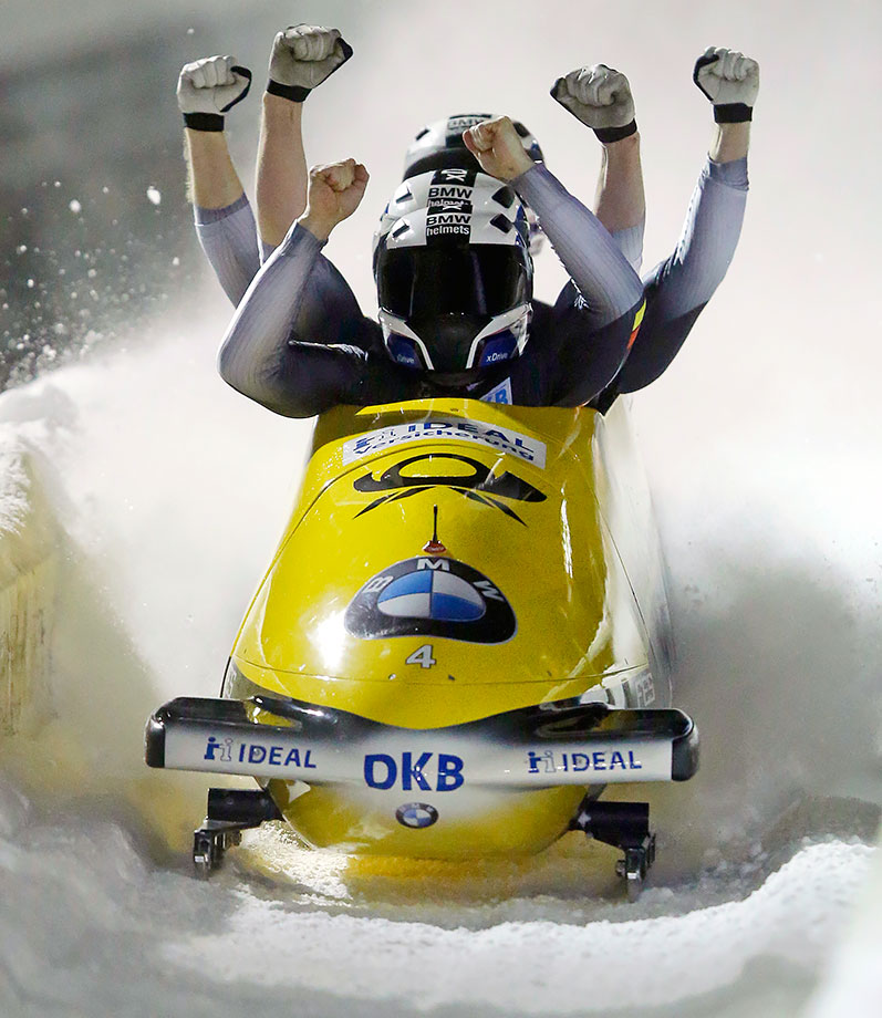 Germany's Nico Walther and teammates are either celebrating after winning their four-man bobsled World Cup race, or they're impersonating a Hindu deity.