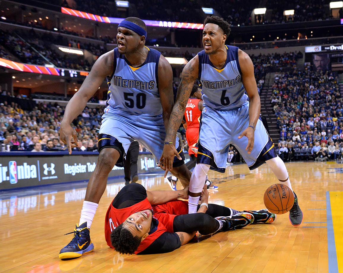 Memphis Grizzlies forward Zach Randolph and guard Mario Chalmers stand over New Orleans Pelicans forward Anthony Davis.