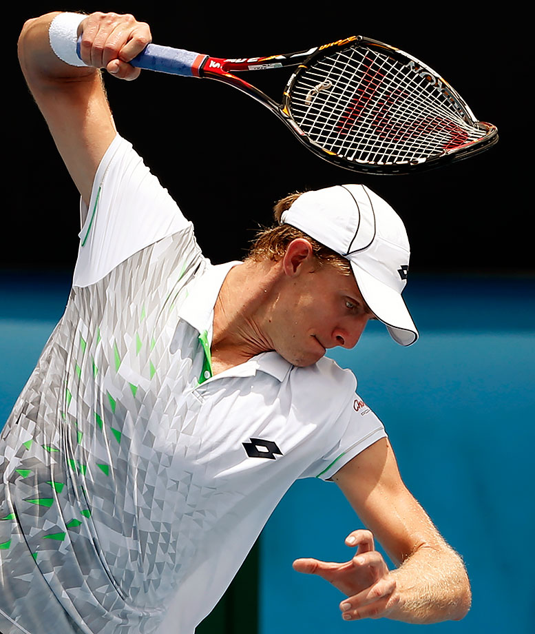 Kevin Anderson smashes his racket in frustration during his match against Rajeev Ram at the Australian Open.