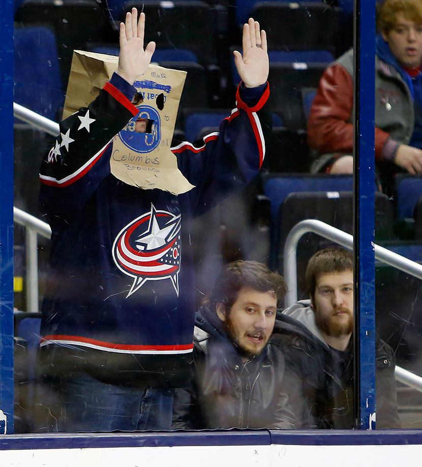 A Columbus Blue Jackets fan wears a bag over his head during another Blue Jackets loss in a game against the Calgary Flames in Columbus, Ohio.