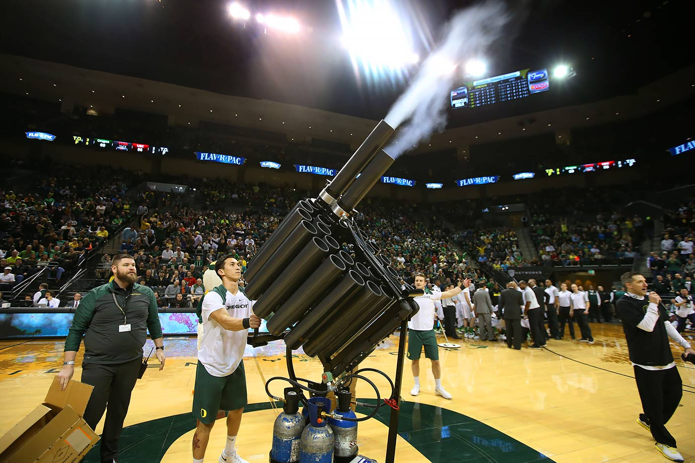 To meet the fans demand for more free T-shirts, the Oregon Ducks appear to have concocted a dual gatling T-shirt gun during a basketball game in Eugene, Ore.