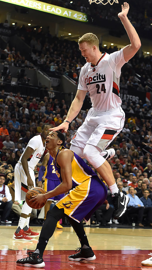 Los Angeles Lakers guard Jordan Clarkson gets Portland Trail Blazers center Mason Plumlee up in the air with a head fake during the game in Portland, Ore.