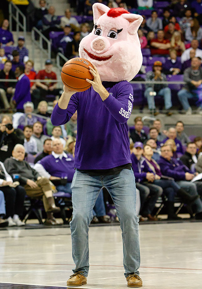 A TCU Horned Frogs fan participates in a contest requiring him to shoot a basketball while wearing a pig's head (we hope) during a timeout in the game against the Iowa State Cyclones at Ed & Rae Schollmaier Arena in Fort Worth, Texas.