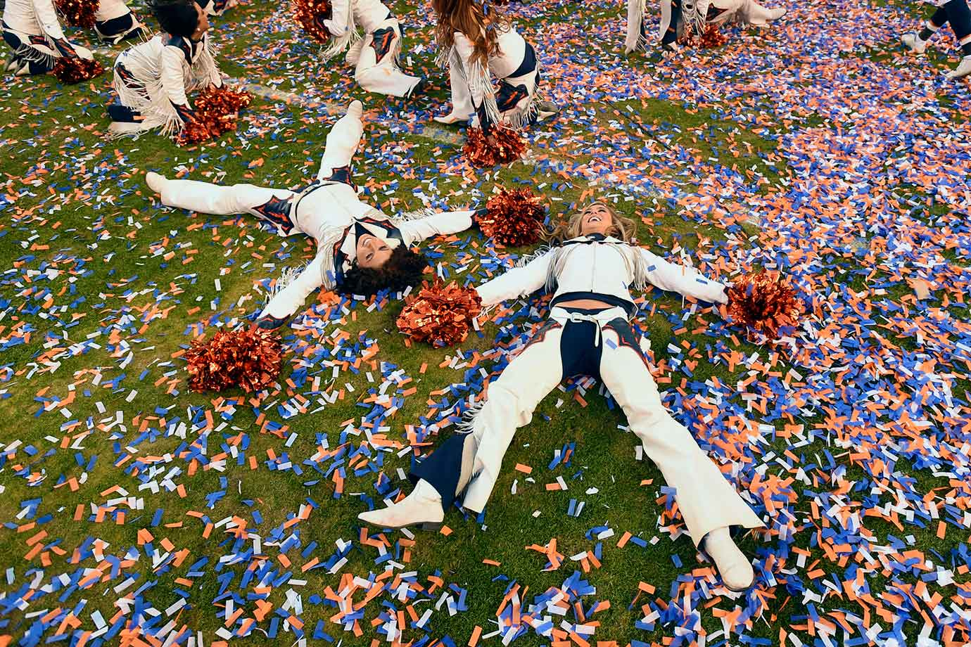 Denver Broncos cheerleaders make angles in the confetti after the team's 20-18 victory over the New England Patriots in the AFC Championship Game at Sports Authority Field at Mile High in Denver.