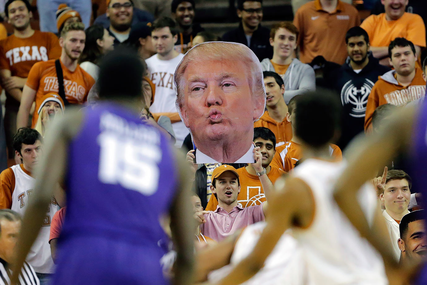 A Texas Longhorns fan waves a big head of Donald Trump in an attempt to distract the TCU Horned Frogs during their basketball game in Austin, Texas.
