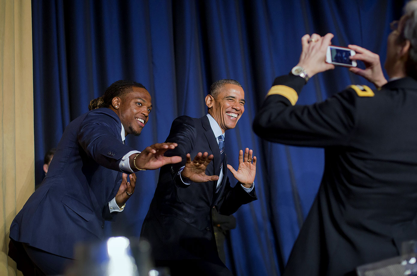 "President Barack Obama and University and Heisman Trophy winner Derrick Henry strike a ""Heisman pose"" for a photo during the National Prayer Breakfast in Washington, D.C."