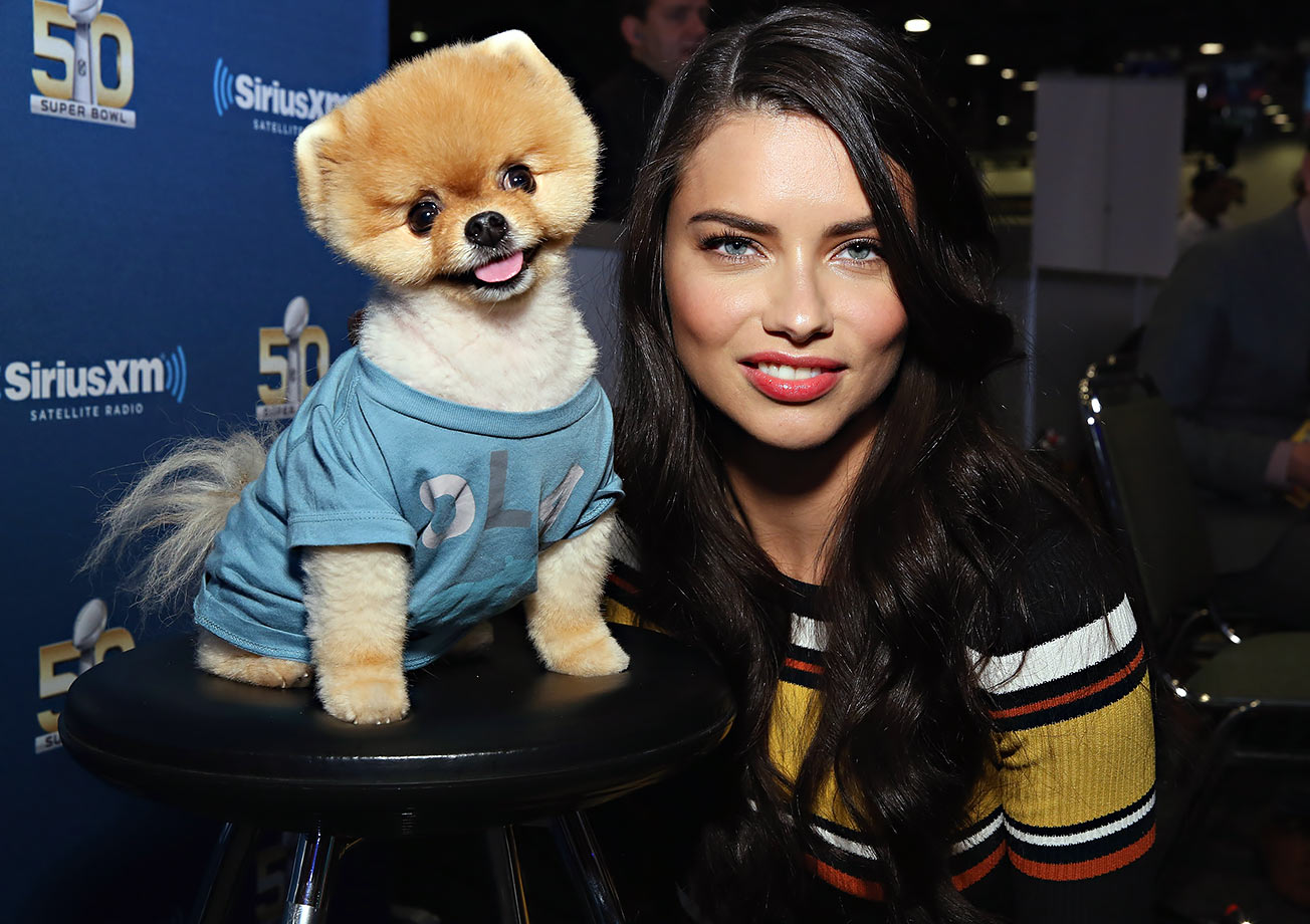 Jiffpom and Adriana Lima poses together at Super Bowl 50 Radio Row at the Moscone Center in San Francisco.