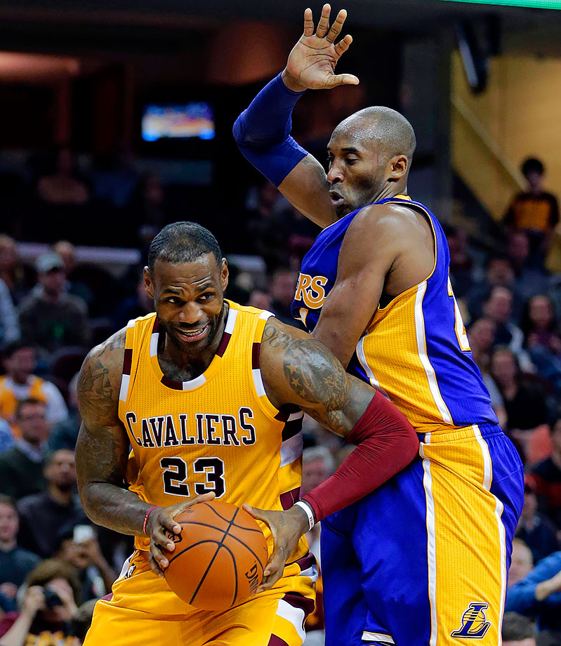 LeBron James drives around Kobe Bryant in the second half of the Cleveland Cavaliers game against the Los Angeles Lakers in Cleveland.