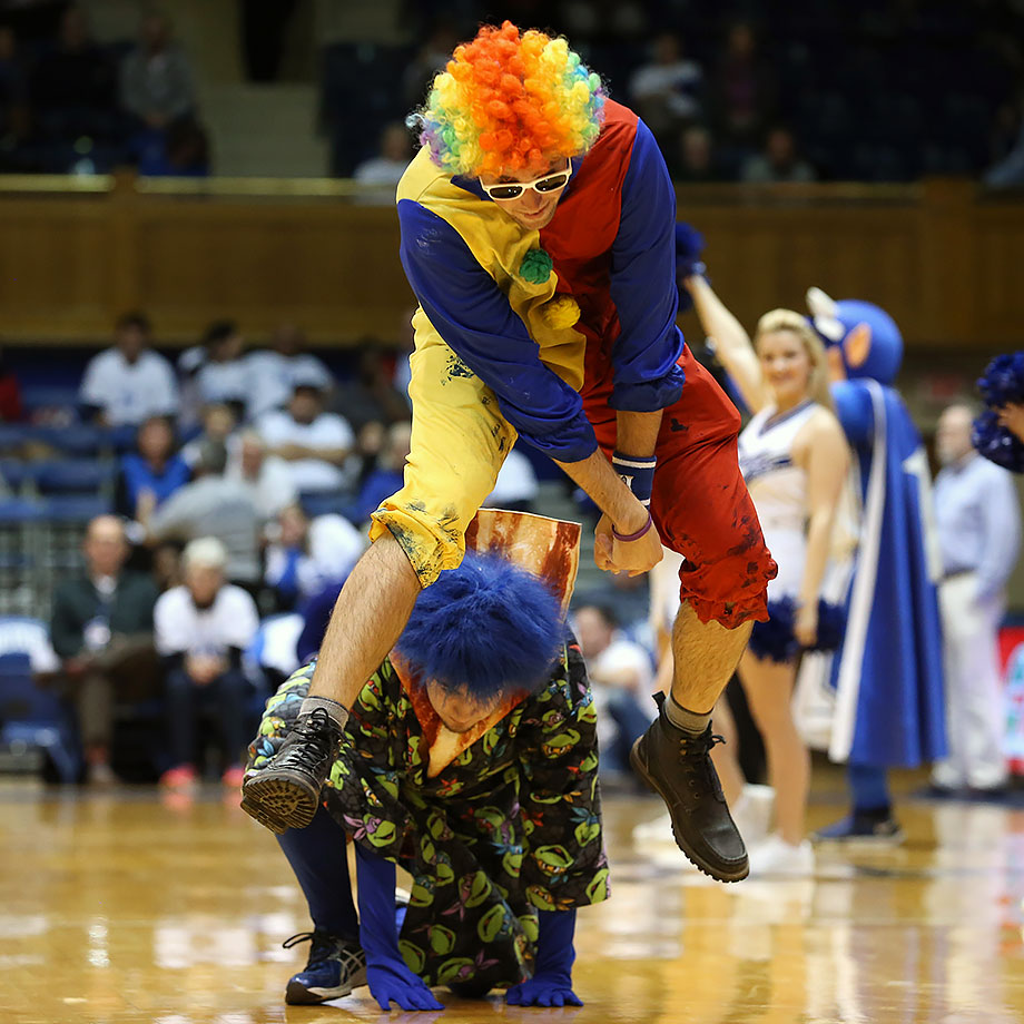 Duke fans, known as Cameron Crazies, engage in a leapfrog contest during a timeout in the women's basketball game against Florida State in Durham, N.C.