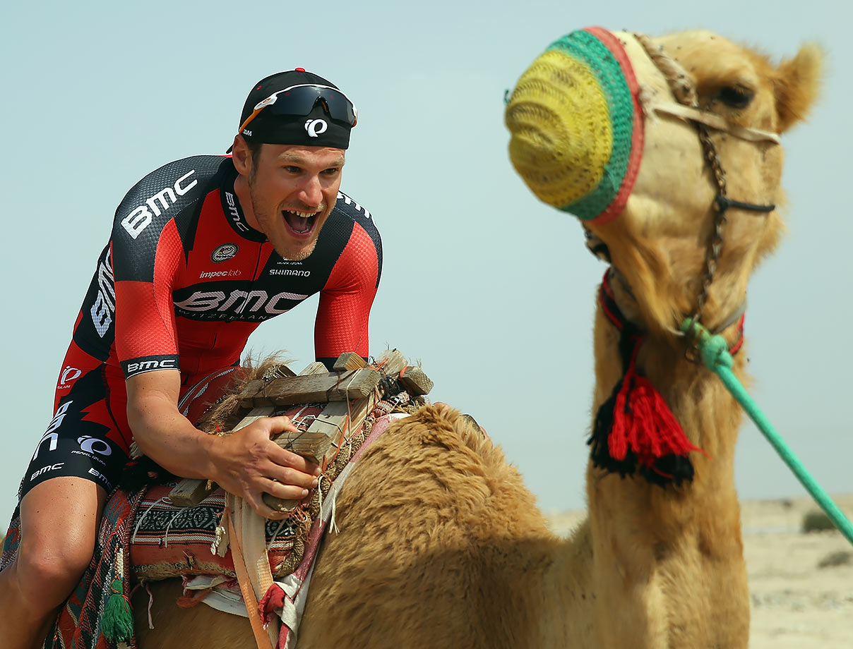 Jean-Pierre Drucker of Luxembourg and the BMC Racing Team sits on a camel at the start of stage four of the 2016 Tour of Qatar, a 189km road stage from Al Zuberah Fort to Madinat Al Shama.