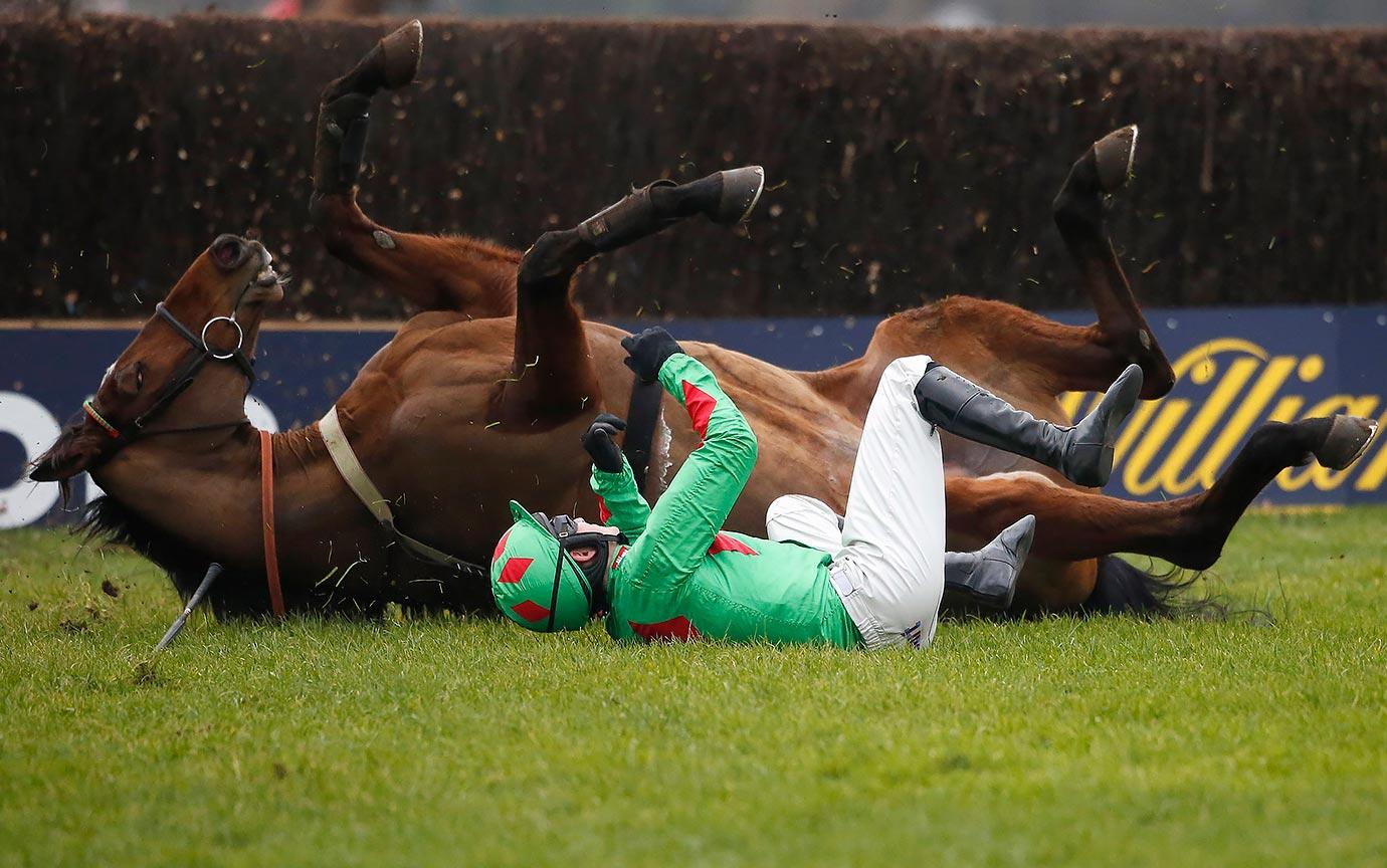 Tom Bellamy riding Devil To Pay fall in similar fashion at Kempton Park Racecourse in Sunbury, England.