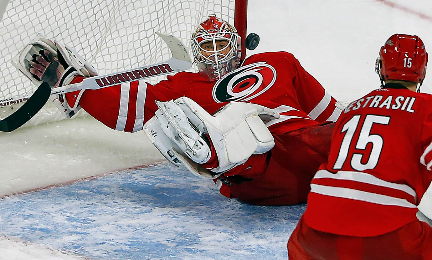 Eddie Lack makes a save during the third period of the Carolina Hurricanes game against the New York Islanders in Raleigh, N.C.