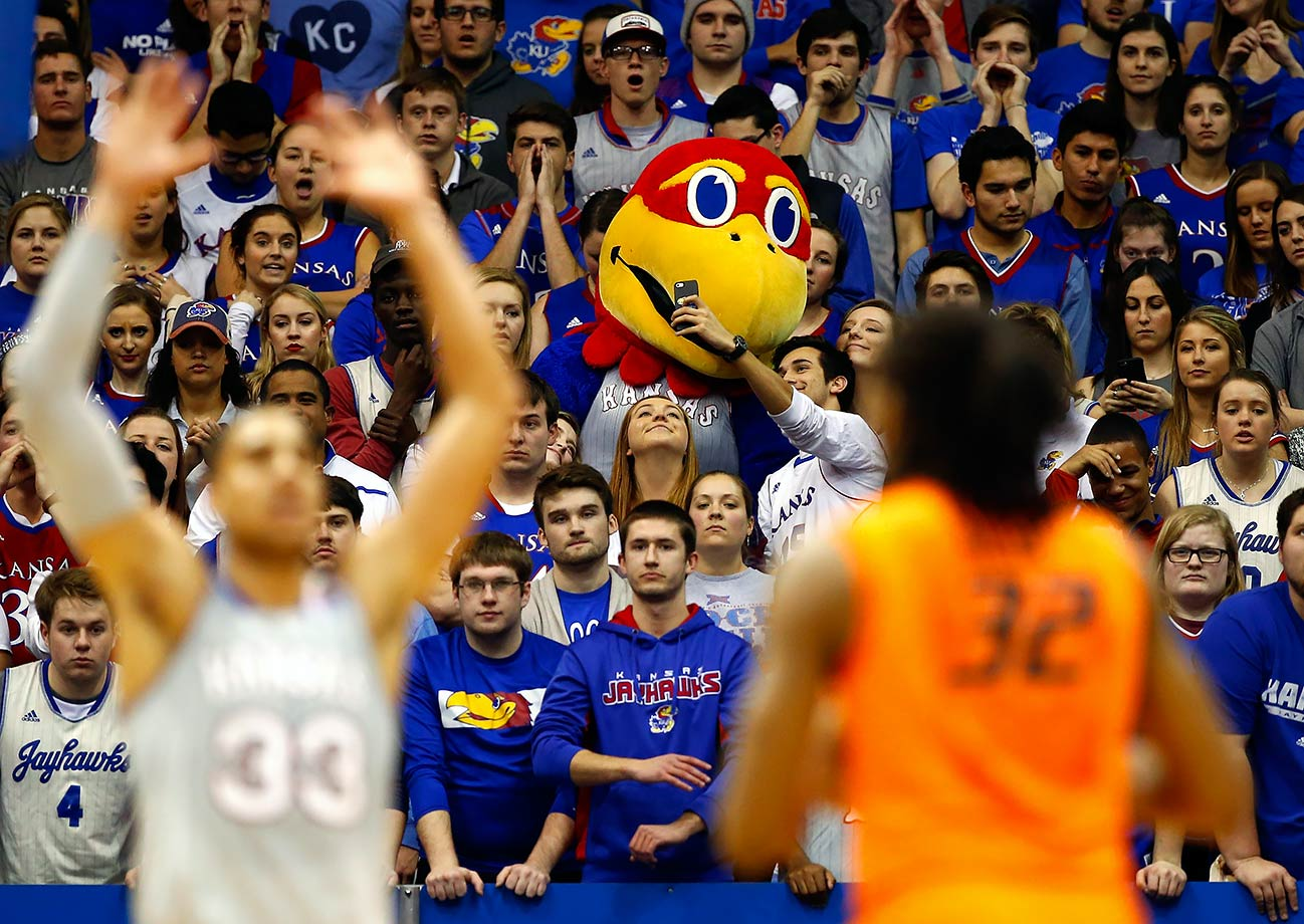 A Kansas fan takes a selfie with Jayhawks mascot Big Jay during the game against Oklahoma in Lawrence, Kans.