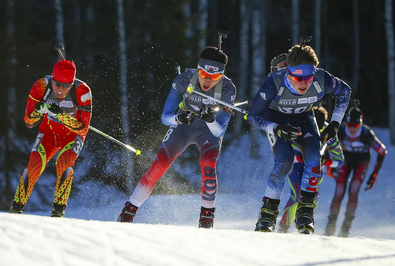 Zhenyu Zhu (CHN), Woojin Wang (KOR) and Vaclav Cervenka (USA) compete in the Biathlon Men's 10km Pursuit at Birkebeineren Biathlon Stadium on Feb. 15, 2016 during the Winter Youth Olympic Games in Lillehammer, Norway.